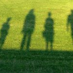 shadows-of-family-in-sunny-meadow
